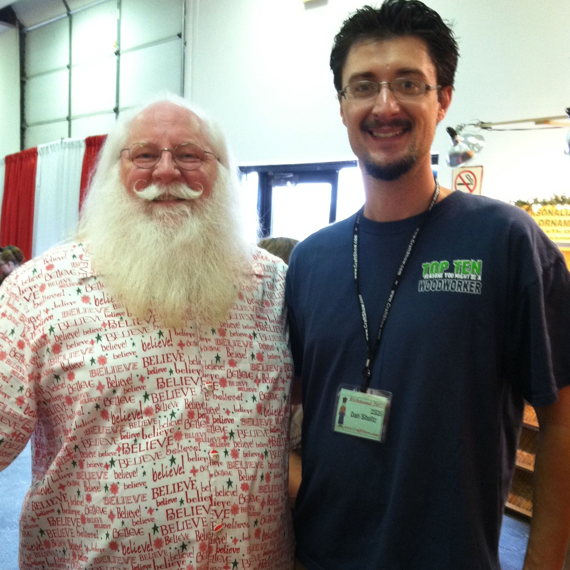 Santa often makes appearances. Here he is with Dan.